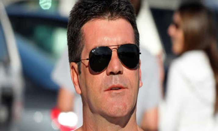 is simon cowell going to be a dad