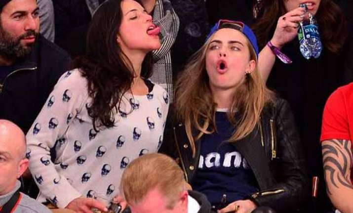 it s confirmed michelle rodriguez is dating cara delevingne