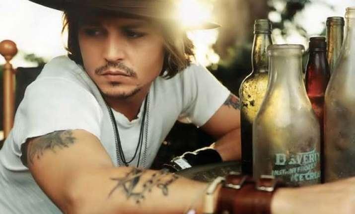 johnny depp wants to frame his tattoos as memoir