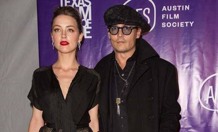 johnny depp escorts fiance amber heard to award event