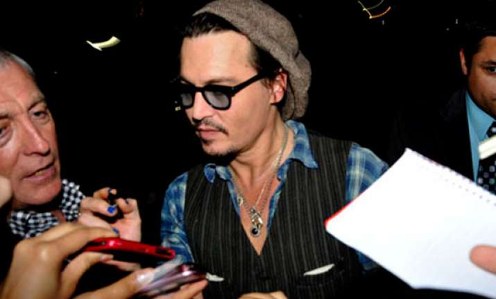 johnny depp banned from talking the rum diary with abc