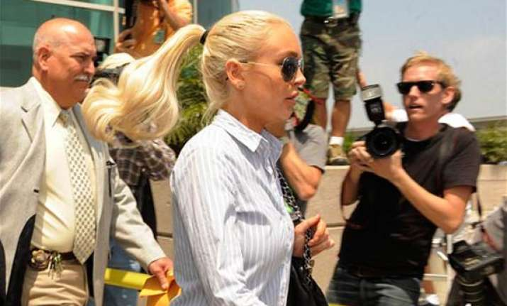 judge tells lohan no more parties at house