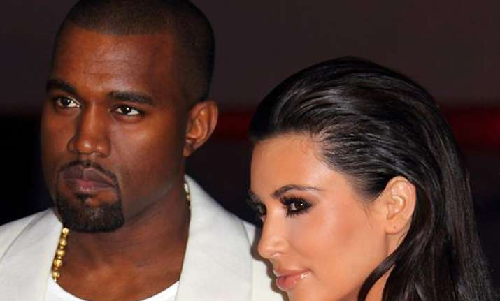 kanye west to move in with kardashians