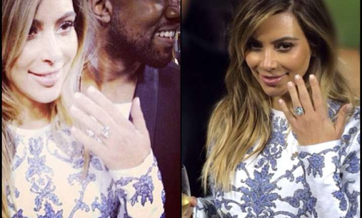 kim kardashian gets engaged to beau kanye on her 33rd