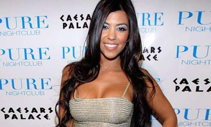 kourtney kardashian dismisses engagement rumors