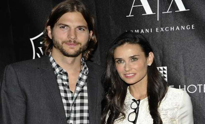 kutcher files for divorce from moore