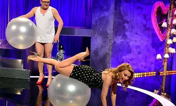 kylie minogue displays her sexercize skills on chat show