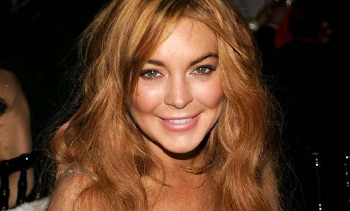lindsay lohan settles dispute with clothing firm