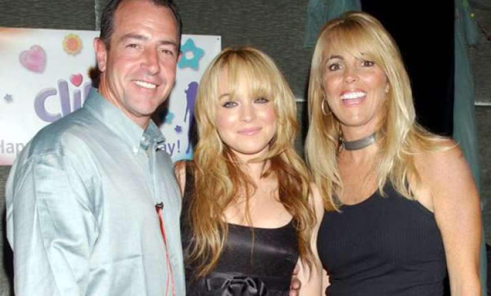 lohan s parents banned from reality show