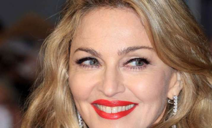 madonna to direct adaptation of novel ade a love story