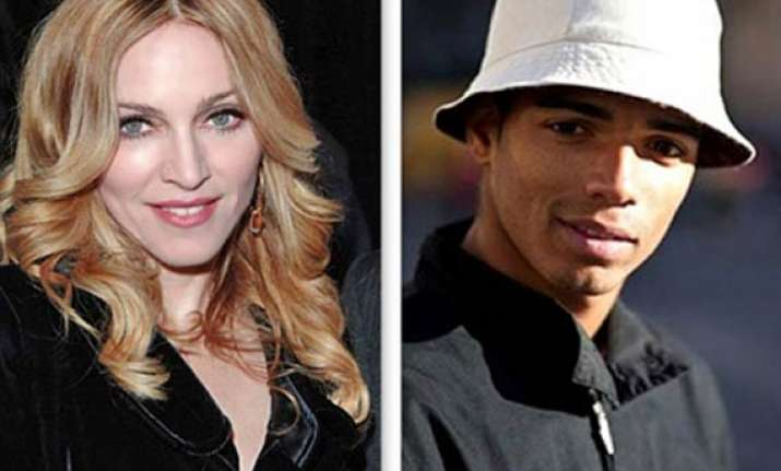 madonna splits from muslim toyboy lover over religious