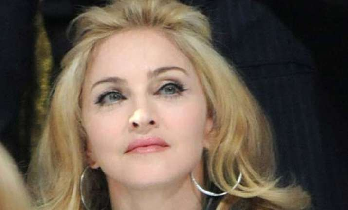 madonna shows derriere to raise fund