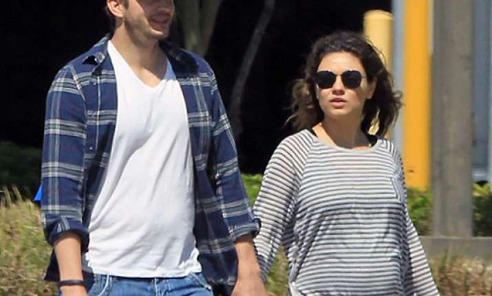 finally mila kunis opens up about pregnancy see pics