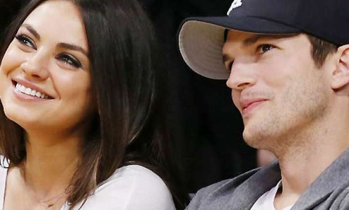 is kunis expecting first child with fiance kutcher