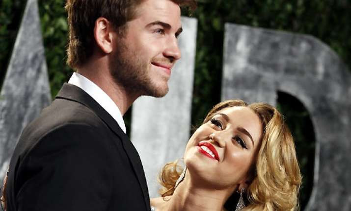 miley cyrus wants ex beau liam back in her life