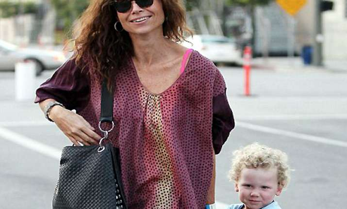 minnie driver guilty for not giving enough time to son