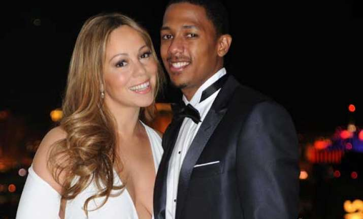 nick cannon praises wife mariah s pet care habit