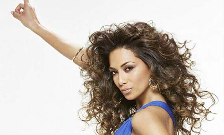 nicole scherzinger dons 70s look at the re launch of beauty