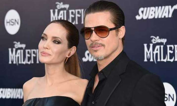 omg brad pitt gets punched at maleficent premiere