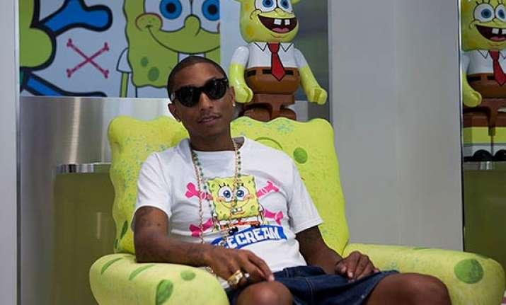 pharrell williams gets custom made cartoon socks