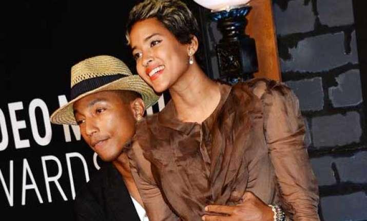 rapper pharrell williams marries longtime girlfriend helen