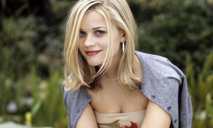 reese witherspoon officially joins the cougar clan