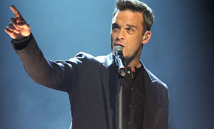 robbie williams to quit take that again