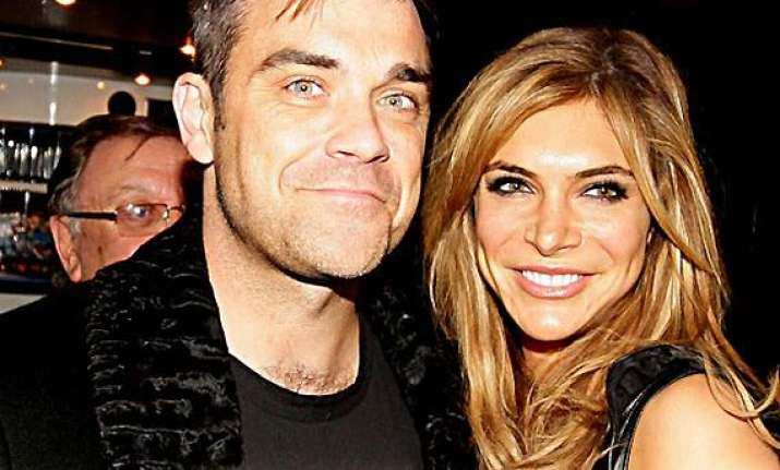 robbie williams to move back to us for wife