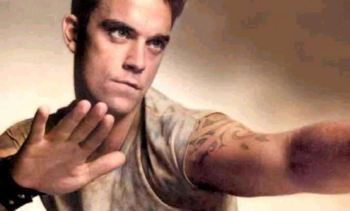 robbie williams gives parenting tips to adele