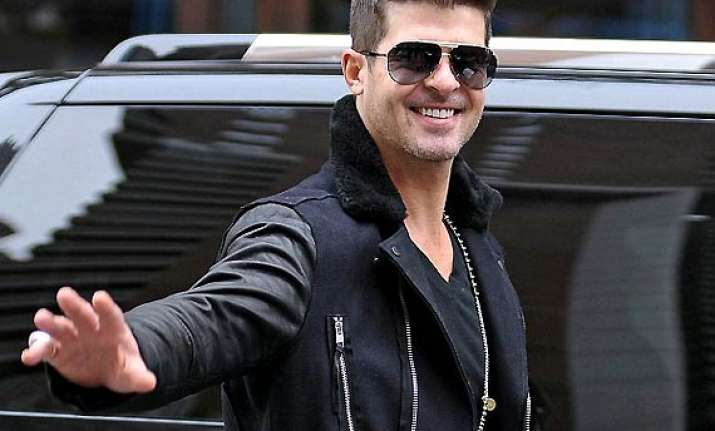 robin thicke dwells into music post separation with paula