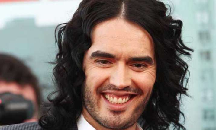 russell brand turns yoga teacher