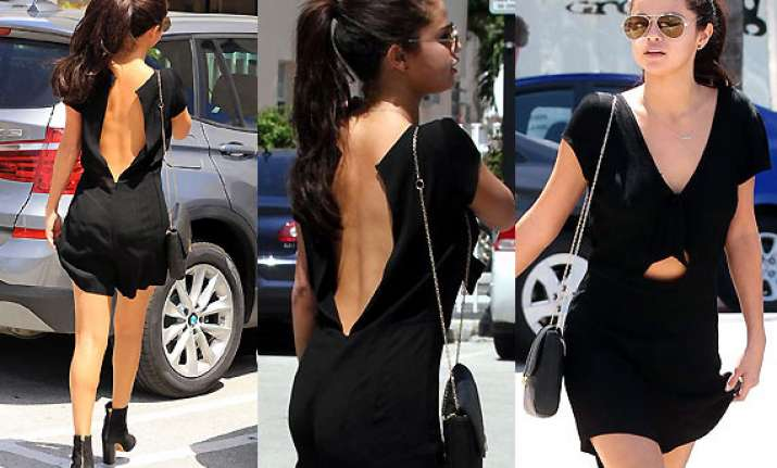 oop selena gomez suffers wardrobe malfunction
