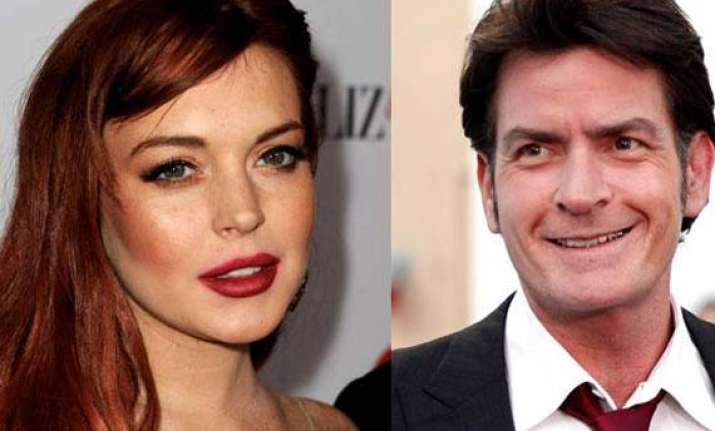 sheen payed lohan s tax outstanding
