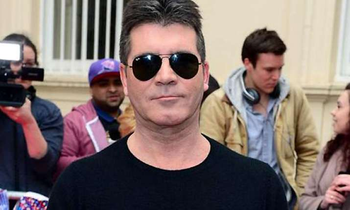 simon cowell excited to become father