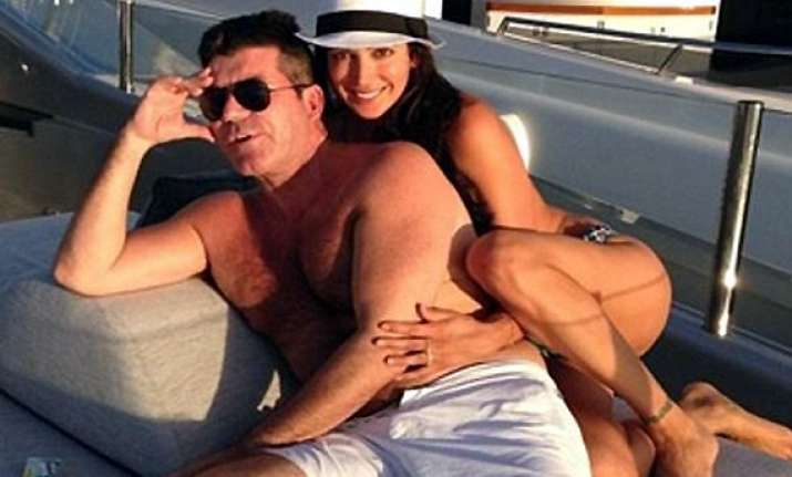 simon cowell to give pregnant lover a mansion