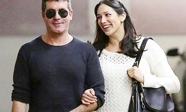simon cowell lauren silverman heading to the hamptons