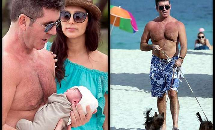 simon cowell warned for taking pet pooches on beach see pics