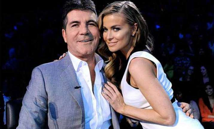 simon cowell finds carmen electra adorable