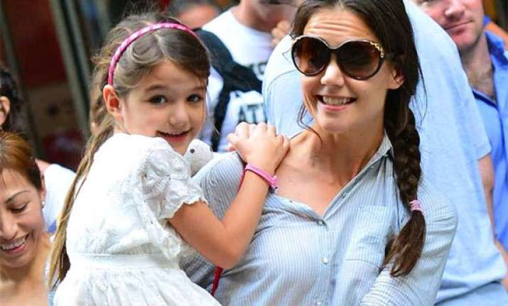 suri cruise suffers broken arm