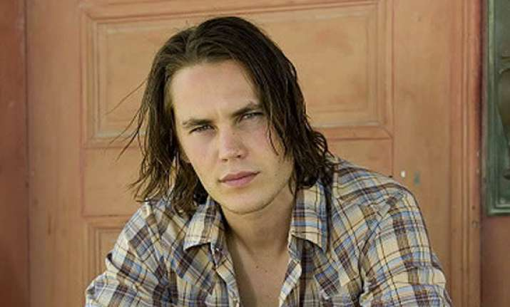 taylor kitsch gets his name up in lights