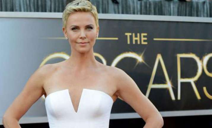 theron helps oscars guard after seizure