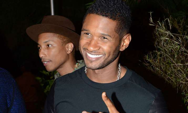 usher quits the voice for his kids