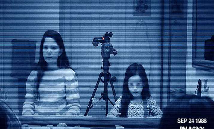 paranormal activity 3 may rake in 30 million plus opening