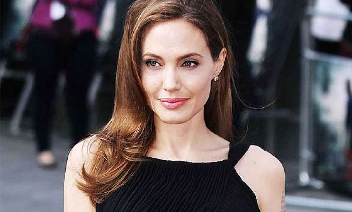angelina jolie talks about her breast surgery says she is