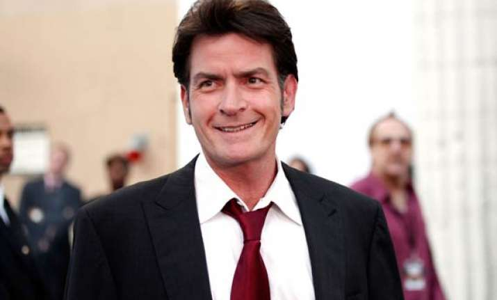 charlie sheen s fiancee still married to another man