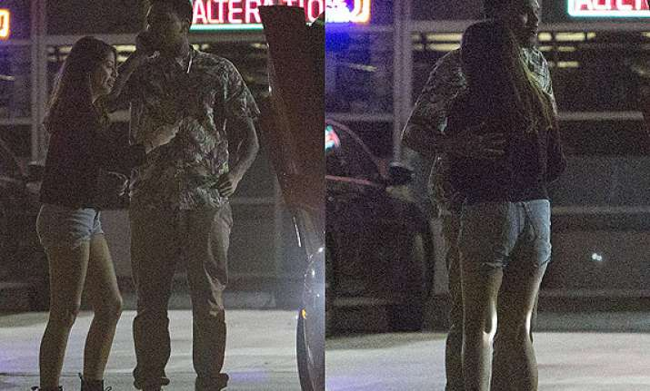chris brown caught hugging mystery woman