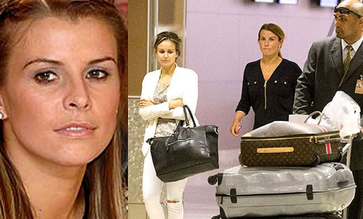 coleen rooney hits out at ba for ransacked luggage