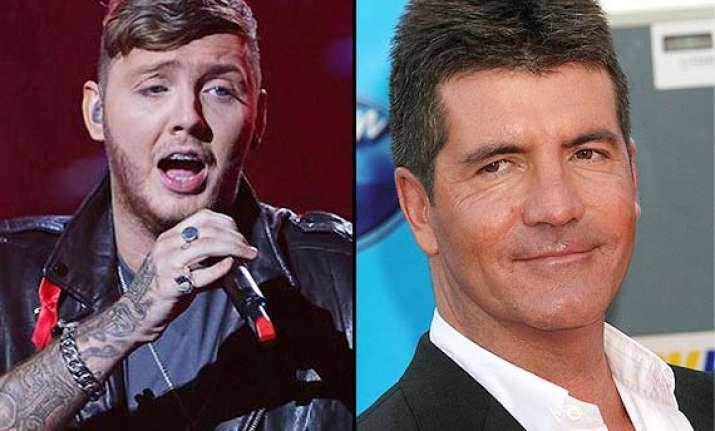 cowell fires james arther for lyrics glorifying terrorism