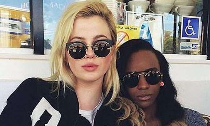 ireland baldwin confirms lesbian relationship rapper angel