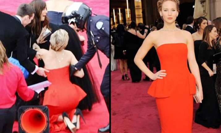 oscars 2014 jennifer lawrence trips again on the red carpet